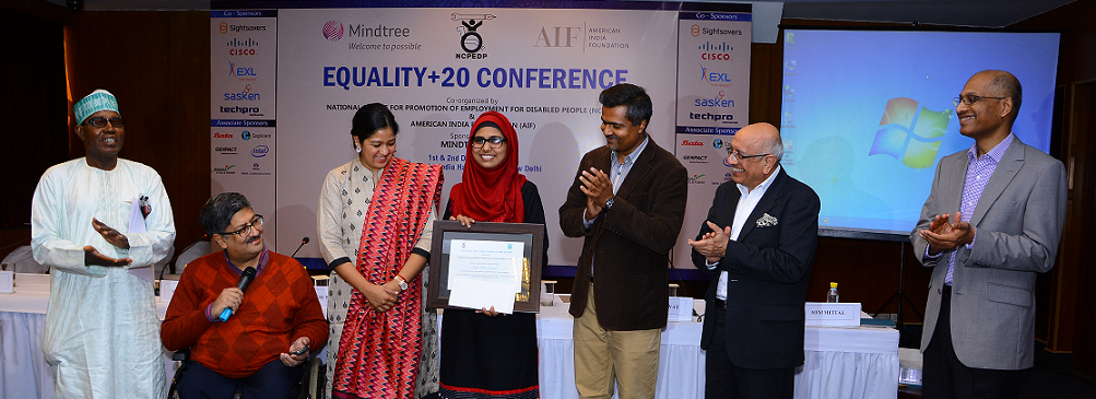 The 'Signs of our Times' Logo Competition's winning logo by Ms. Amna Swaleh being unveiled at the opening of the Equality+20 Conference on 1st December, 2015 by Ms Sweta Rawat, Chairperson, The Hans Foundation.